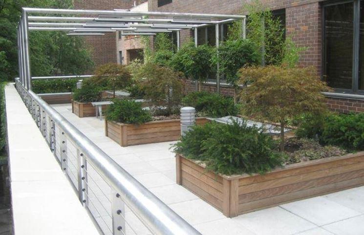 Giardino in terrazzo progettazione giardino for Arredo giardino terrazzo