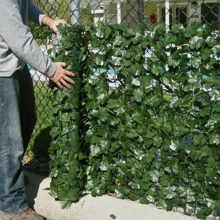Siepe artificiale piante finte siepe artificiale for Rete con foglie finte